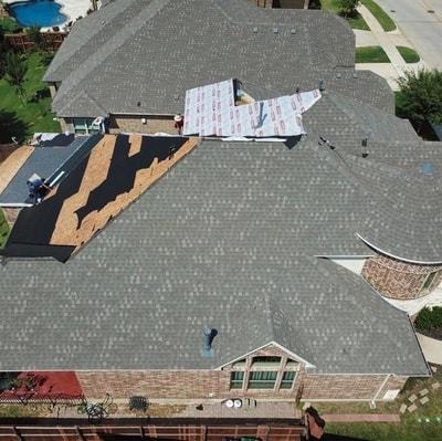 A beautiful drone picture showing a house getting it's roof replaced after hail hit this past summer.